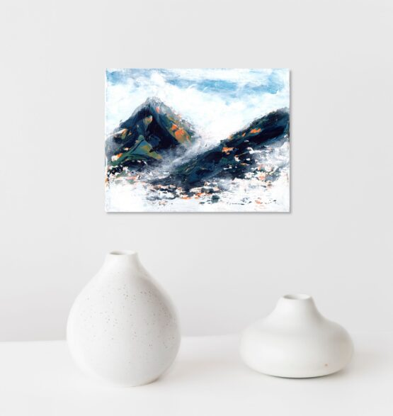 Blue, green and hints of orange and yellow marbled abstract mountain against a wispy white cloudy back ground with bits of blue sky peeking through original painting frameless, hung on a white wall above a white shelf with two odd shaped white vases with light brown speckles in the pottery