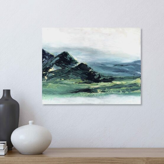 Abstract Mountain Landscape Painting with brlue and green marbled mountains against a white sky and white water, hung on a white wall above a natural wood shelf with a black vase, a white vase and a small stack of books