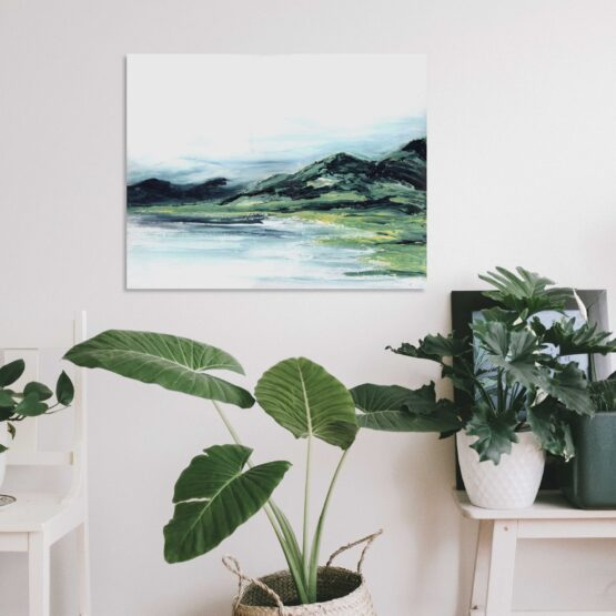 Abstract Mountain Landscape Painting with brlue and green marbled mountains against a white sky and white water, hung on a white wall above a green potted plant and white furniture