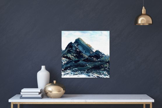 Abstract art Mountain Landscapes Copper Orange Blue mountain original art work by Melissa Critchlow Mockup on blue wall with a white table Fine Art Abstract Landscape Print